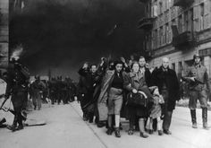 Jews are forced to march by SS soldiers as the Warsaw ghetto is destroyed in April 1943
