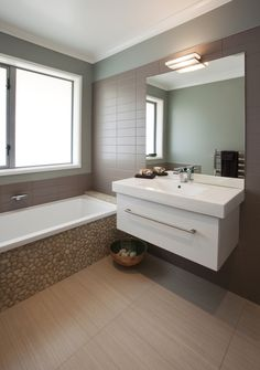 The family bathroom features a pebble effect around the bathtub Family Bathroom, Bathroom Ideas, Easy Tile, Master Bath, Bathrooms, Bathtub, Mirror, House, Furniture