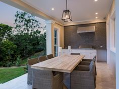 outdoor kitchen with grey glass subway tiles 10 Sunnymeade Place 'Jabiru Estate', Mudgeeraba