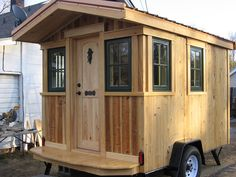 A tiny traveling house on wheels in Western, North Carolina. Owned and shared by Frank Belo. Traveling Carpenter's Home Away From Home.