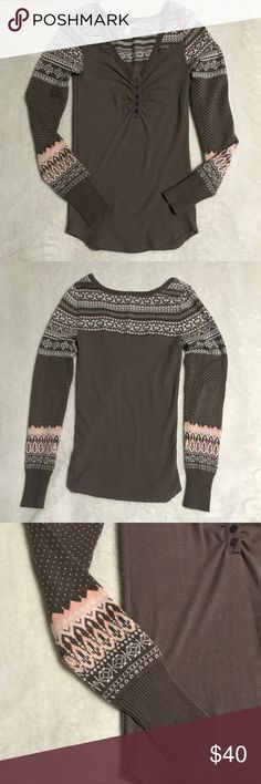 """We the free people Small winter thermal top Lightly worn we the free (free people) small winter thermal. Has thermal body and fair isle sweater sleeves. Flat measurements: chest- 14"""", waist- 13"""", hips- 14"""", length- 27.5"""" Free People Tops"""