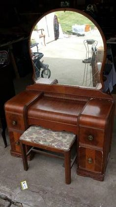 Antique 1950's Waterfall dresser, headboard and vanity set with mirror and seat. They are in used condition but operational. They do have pieces of the wood vaneer missing from use. Please serious...