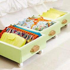 Old drawers on rollers for under bed storage.