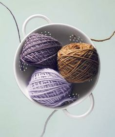 To prevent balls of yarn from tangling, string the end of each through a colander hole.