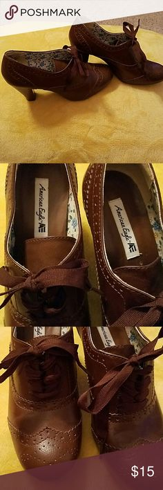 """Brown lace up heels Size 9.5 but fits more like a 9.  I am a 9 and size fits but heel is too tall for me.  Heel 3 1/2"""" . Reposhed.  Asking what I gave for them myself. Brown faux leather.  Lace up.  So cute.   Good condition. American Eagle by Payless Shoes"""