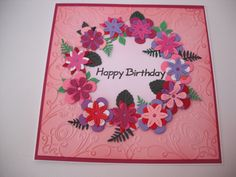 Tattered Lace Dies on embossed background.  (Too pink !)