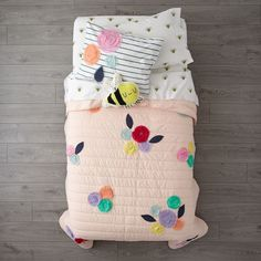 Shop Bee's Knees Bedding. Your little ones will definitely be buzzing about this floral bee bedding. The pink floral quilt and sham have appliqued flowers that provide plenty of color and texture.