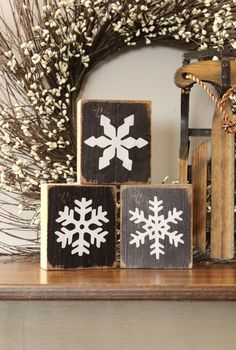 Winter mantel decor. Love the blocks and mini sled