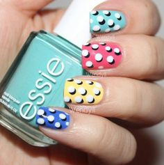 Blue, yellow, pink, and sky blue nails with a 3D design of white polka dots.  #3D nails