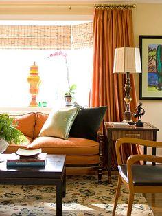 Comfortable Elegance orange, warm, updated retro livingroom.