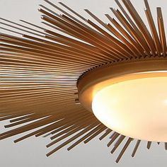 DIY SUNBURST CEILING LIGHT - $30 flush-mount fixture with plain frosted glass + gold spray paint. Leave just a little wiggle room between the metal rim and the ceiling so can wedge chopsticks in. The tension holds the chopsticks in place just fine, and makes it easy to arrange them any way you want to. (alternating pattern of 1 long and 2 short chopsticks all the way around. The Global Views inspiration light retails $700)