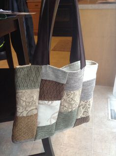 Bag made from upholstery samples. Pick a family of warm colors, cut into squares, sew lining and straps for a cute carry bag.