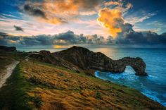 Atomic Clouds by The Narratographer  There were some strange clouds this morning at Durdle Door. I was supposed to go to Ladram Bay, but having woken up way too late to make the drive in time, I settled once more on Durdle Door. When I arrived, the sky was bland and a little insipid, but