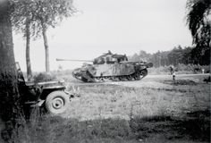 Centurions moving up at the crossroads near Bispingen, West Germany, 1953. Photograph by Private Derek Lamb, 1st Battalion King's Royal Rifle Corps, Germany, 1953. Lamb was a radio operator during his National Service. Initially introduced in 1945, just too late for World War Two, the Centurion was produced until 1966, running through 13 variants. It was undoubtedly the finest tank of its time and served with the British Army in Korea and Suez and with Australian forces in Vietnam.