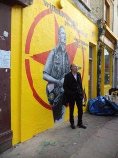 Joe Strummer mural... With Mick Jones in front of it