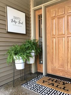 #address #created #created #address #custom #enamel #enamel #custom #stands #stands #decor #plant #front #plant #frontFront door decor with enamel plant stands and custom address sign created by Whi... -