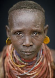 Old Karo tribe woman - Ethiopia This tribe may no longer exist soon as a big dam will be build in Ethiopia on Omo river, and will have huge consequences on their life..