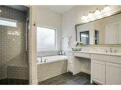 Gray and white bathroom // Gray subway tile and gray tile floors, oversized mirror, white vanities