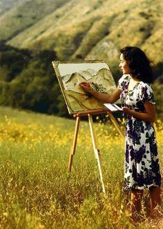 Elizabeth Taylor painting a landscape, 1947