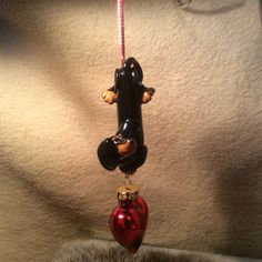 Blk/tan with a glass heart ornament.