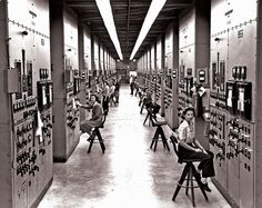 Employees of the Manhattan Project operating calutron control panels at Y-12 National Security Complex, Oak Ridge, circa 1943. US government photo by Ed Westcott