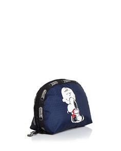 America's favorite cartoon pooch pops up on LeSportsac's latest line of accessories, created in partnership with beloved comic brand Peanuts. This nylon cosmetic case offers an adorable way to organiz