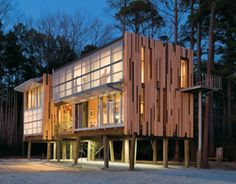 Loblolly House (2007) by Kierantimberlake  Associates. USA. lifted up off the ground, with its irregular cladding, folding shades and exterior stairway, an original and ecologically responsible realization