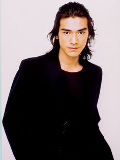1/2 Chinese, 1/2 Japanese - Takeshi Kaneshiro, actor...see him in Red Cliff.
