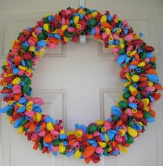 The Birthday Balloon Wreath. Add some curly ribbon and twirled pipe cleaners as well as a happy birthday sign on the top