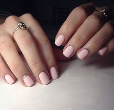 Simple matte pastel pink nail art with jewels