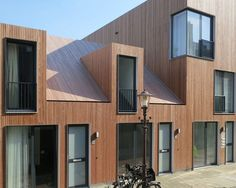 Untreated timber cladding and angular dormer windows feature at this little housing growth in Amsterdam by Dutch studio Architecten (+ slideshow). Timber Architecture, Residential Architecture, Contemporary Architecture, Architecture Design, Wooden Facade, Wooden Houses, Amsterdam Houses, Mews House, Timber Cladding