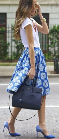 Blue tea length skirt with white t. I especially like the blue color and the pattern.