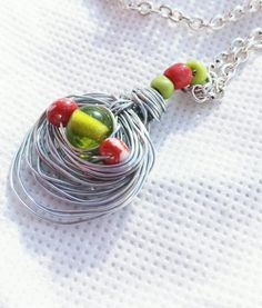 Check out this item in my Etsy shop https://www.etsy.com/listing/214366996/beaded-wire-necklace-wire-wrapped-olive