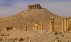 JOJO POST STAR GATES- PALMYRA. Hilltop Fort In The Ancient city of Palmyra, PRRSIA. Today: Syria. The site of Palmyra is an oasis in the Syrian desert, north-east of Damascus, it contains the monumental ruins of a great city that was one of the most important cultural centres of the ancient world in Persia. it was listed UNESCO World Heritage in 1980.