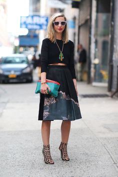 """""""Interesting. A lot going on here. I am immediately drawn to the shoes, which are quite cool and the handbag or whatever that is called, really pops in that color. I am not really a fan of skirts in that mid-range, I think they should be either short or long and fitted."""" -Steve Diego Zuko  - HarpersBAZAAR.com"""