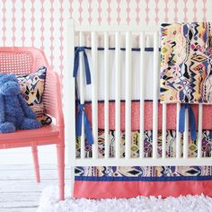 LOVE this navy and coral ikat crib bedding!