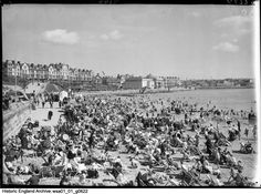 WSA01/01/G0622 Photographer: Walter Scott. A view looking north along South Sands towards The Spa, showing the beach crowded with holidaymakers. South Sands, Bridlington, East Riding Of Yorkshire. In volume 1 of the Walter Scott registers, this is recorded as 'Spa, Children's Corner South Bay'. Aug 1932