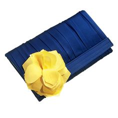 Brides.com: Wedding Color Scheme: Yellow and Navy. A basic navy clutch blossoms into a full-blown beauty with the zap of a floral accent. Clutch, $88, Nelle.