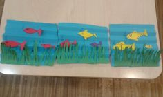 Fishers into the sea....everything is made by coloured paper....the sea in folded and the other parts are cut by scissors!