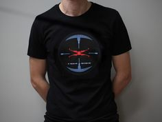 A seven colour design, hand screen printed on a fitted 100% brushed cotton black T-shirt. Inspired by the fictional Tie Fighter targeting system seen in the 1977 film, Star Wars.