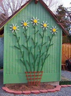 Cute trellis on garden shed.