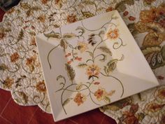 Flowers painted on pottery to match place mats