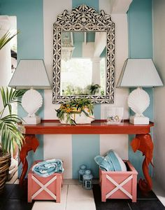 I love this entry by Ruthie Sommers, but especially the elephant console table.  The bone inlaid mirror is a close second.  I also like the striped walls and seashell lamps.  I appreciate that it is a working entryway, but I wouldn't clutter it up with towels if this were my beach house.