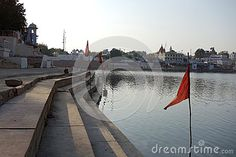 Photo about A view of the city of ancient Pushkar Rajasthan with its ancient lake in front and brilliant red flags blowing in the wind. Image of fort, particular, city - 70659844 Blowing Wind, Red Flag, Flags, India, Stock Photos, City, Building, Travel, Construction