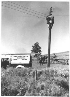 A man is pictured in the above undated image installing power lines near rural Arcadia, Wisconsin as two farm workers look on. Davis added that the exhibit also tries to explain what 'rural identity' is and what even 'constitutes rural America' Lineman Love, Power Lineman, Electrical Lineman, Journeyman Lineman, Art And Craft Videos, Arts And Crafts House, Rural Area, Street Lamp, Ny Times