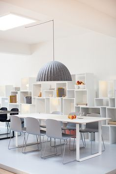 Muuto Under the Bell lamp over a 7070 table matched with Visu chairs.