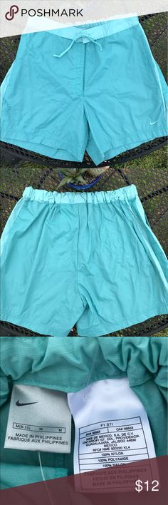 NWT Nike Shorts SIZE M. Aqua Nylon & Dbl Pockets NWT Nike Shorts SIZE M. Aqua Nylon & 2 Pockets - price is firm on this brand-new item, unless you are purchasing in bulk or are a repeat customer🤗 Nike Shorts