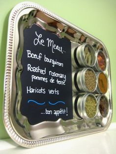 turn an old silver platter into a chalk board spice rack