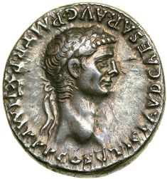 Claudius. Silver Denarius (3.8 g), AD 41-54. Rome, AD 51/2. TI CLAVD CAESAR AVG P M TR P XI IMP P P COS V, laureate head of Claudius right. Reverse : PACI AVGVSTAE, Nemesis advancing right, pulling fold of her robe below neck, holding winged caduceus downwards with which she points at serpent before her. RIC 62; BMC 69; RSC 68.