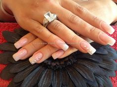 Full set of acrylic nails with pink gelux gel polish and swarofski crystals on ring fingers
